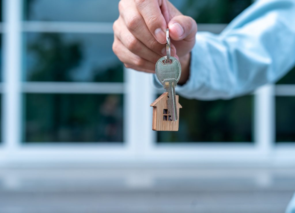 landlord-sales-representative-handing-key-new-landlord
